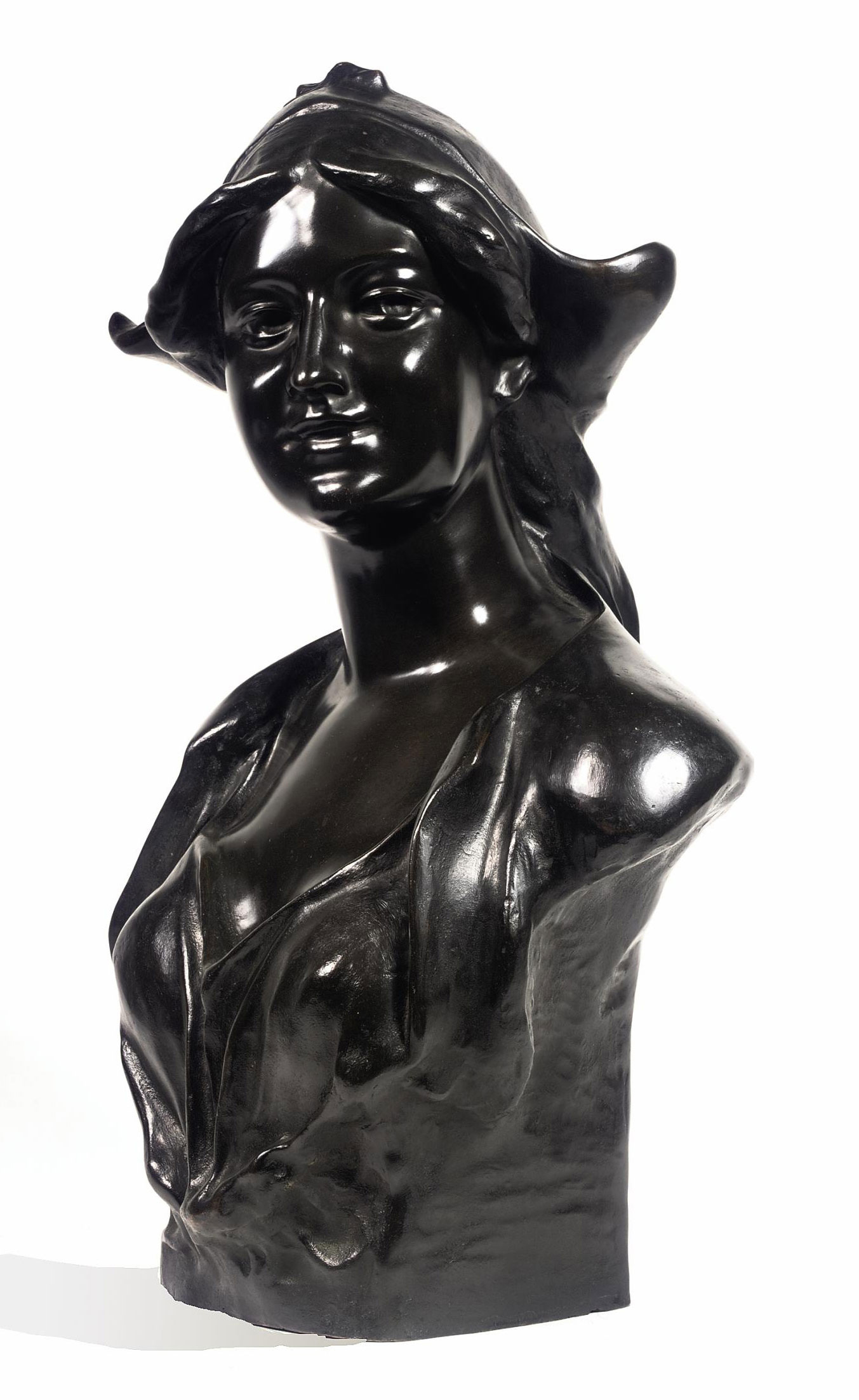 A BRONZE PORTRAIT BUST OF A YOUNG GIRL
