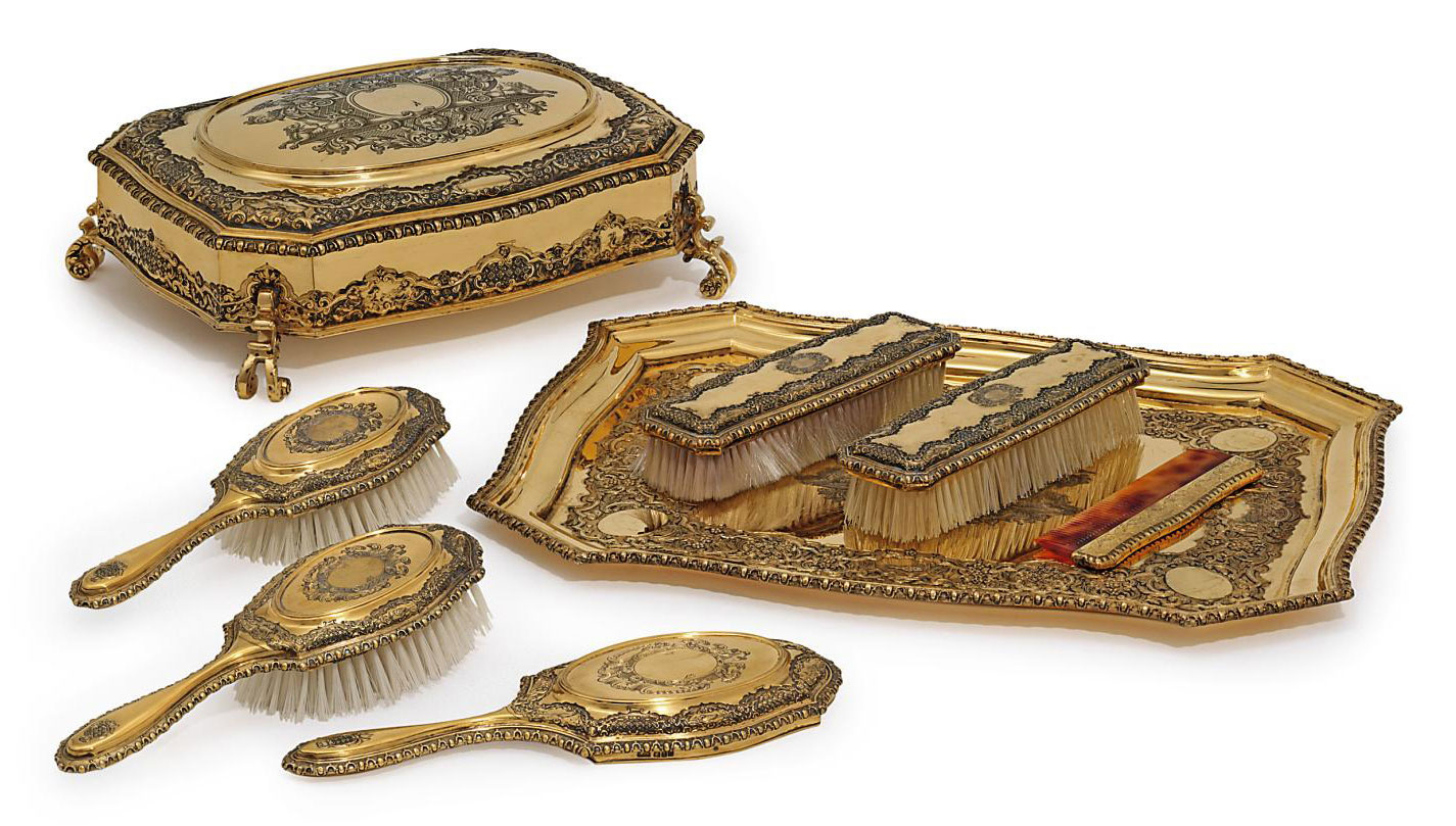 A GEORGE V SILVER-GILT DRESSING-TABLE SERVICE