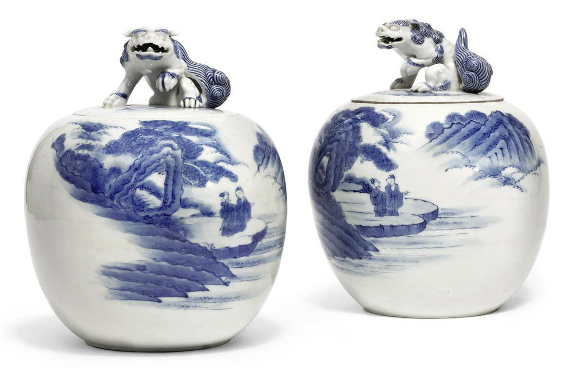 A PAIR OF JAPANESE HIRADO STYLE VASES AND COVERS