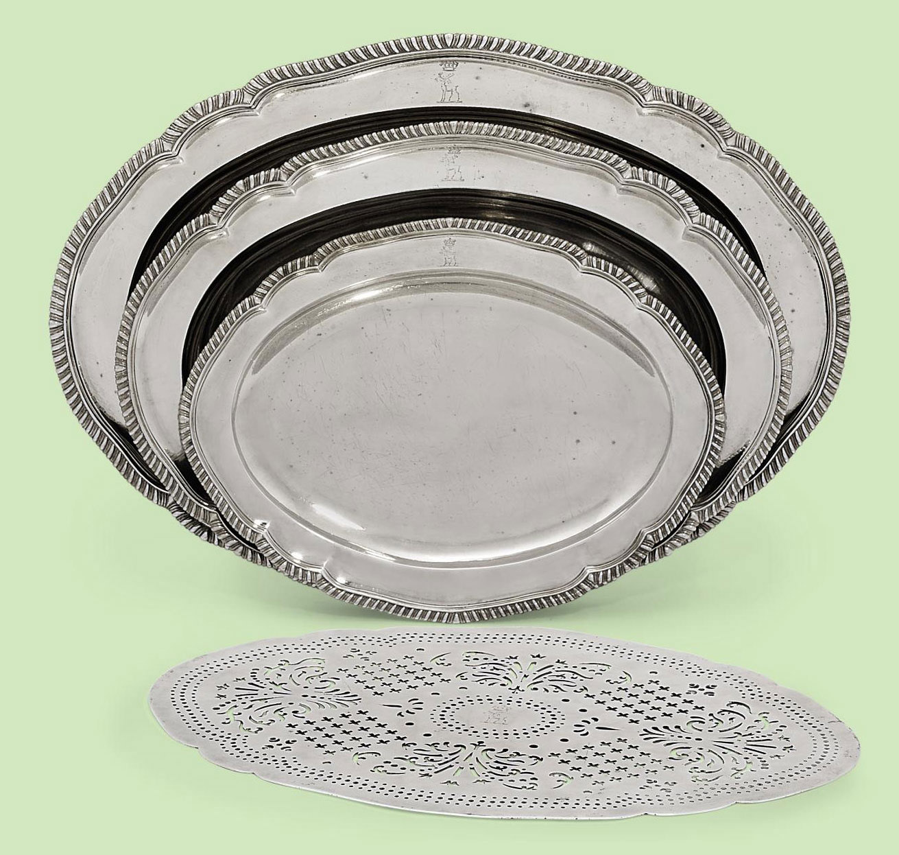 A SET OF THREE GRADUATED GEORGE III SILVER MEAT-DISHES AND A MAZARINE