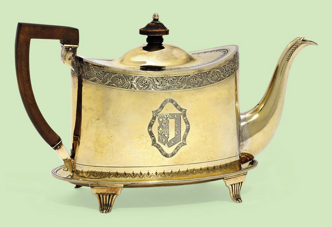 A GEORGE III SILVER-GILT TEAPOT AND STAND