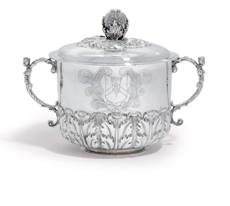 A Charles II silver porringer and cover, London, 1676, makers mark TM monogram. 9⅝  in (24.5  cm) wide over handles. Sold for £17,500 on 10 June 2010  at Christie's in London