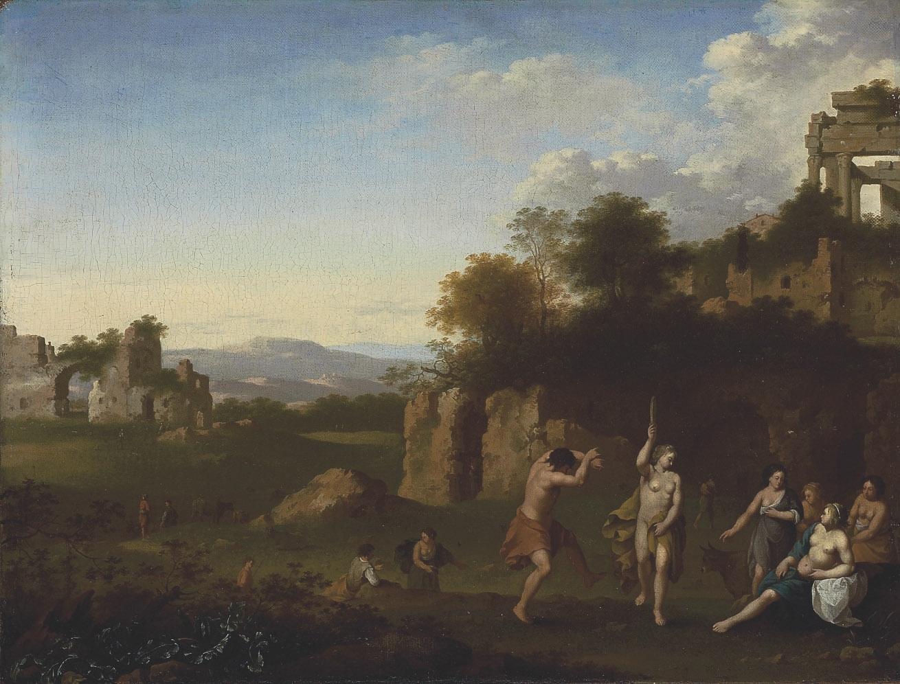 An extensive landscape with a Bacchanal, architectural ruins beyond