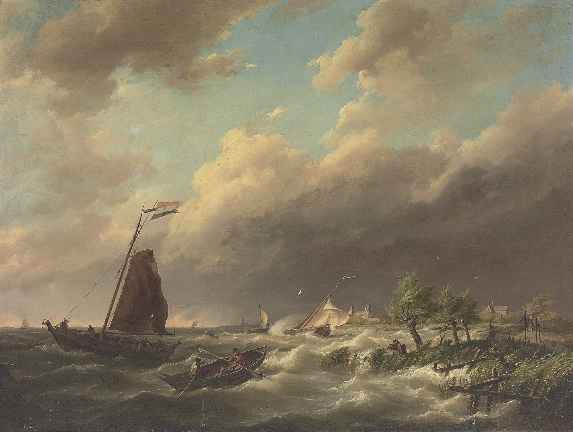 Stormy coastal scene with town beyond