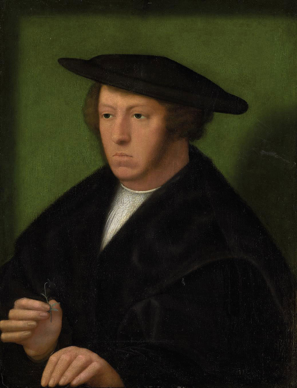 Portrait of a gentleman, half-length, in a fur-lined black mantle and hat, a flower in his right hand