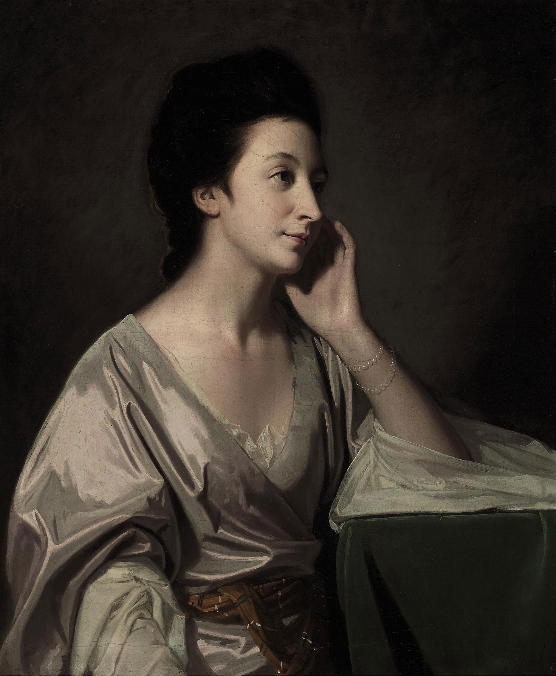 Portrait of Mrs John Gathorne, half-length, in a silver gown, her left elbow resting on a table