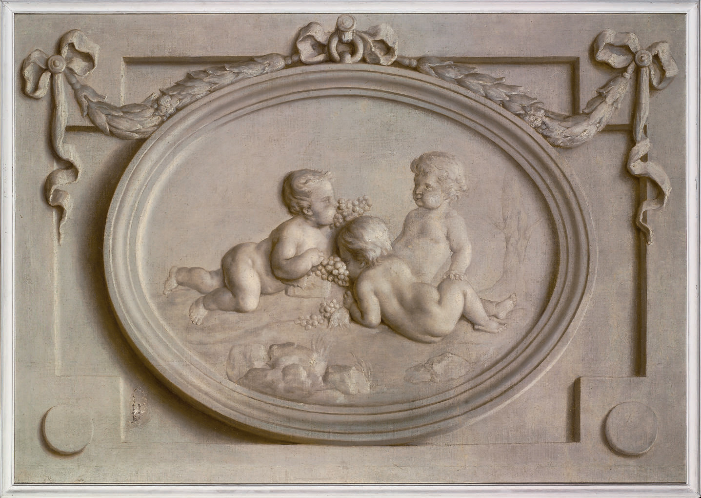 A decorative oval relief with putti, hung with ribbons and garlands