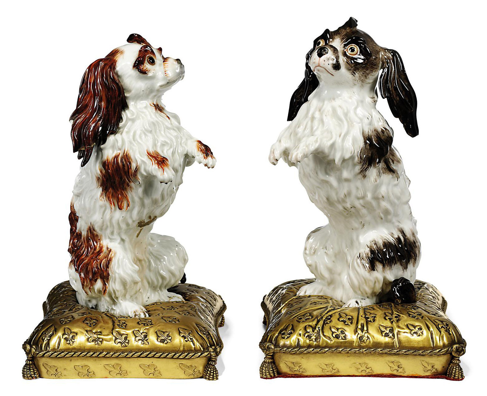 A PAIR OF ORMOLU-MOUNTED CONTINENTAL MODELS OF BOLOGNESE HOUNDS