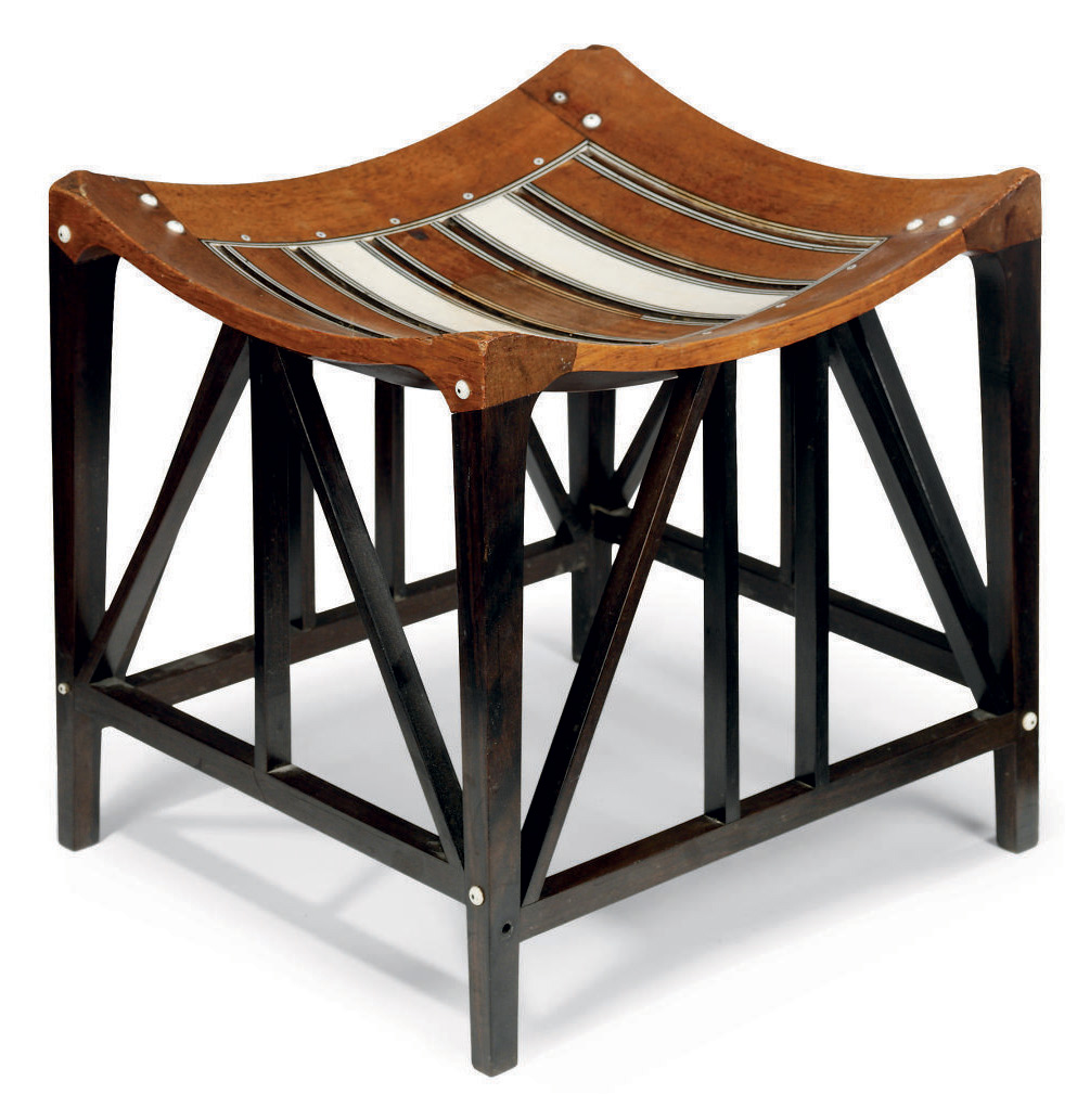 AN ARTS AND CRAFTS ROSEWOOD EBONY AND IVORY 'THEBES' STOOL