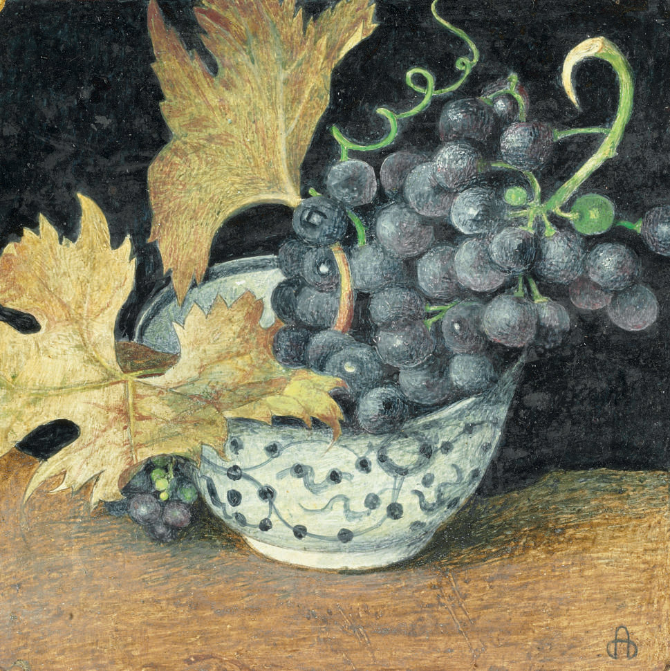 Still life with a bunch of grapes and vine leaves in a chinoiserie bowl