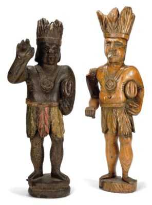 A CARVED AND PAINTED-WOOD TOBA