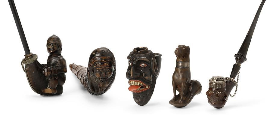 EIGHT NAIVE CARVED WOOD PIPES