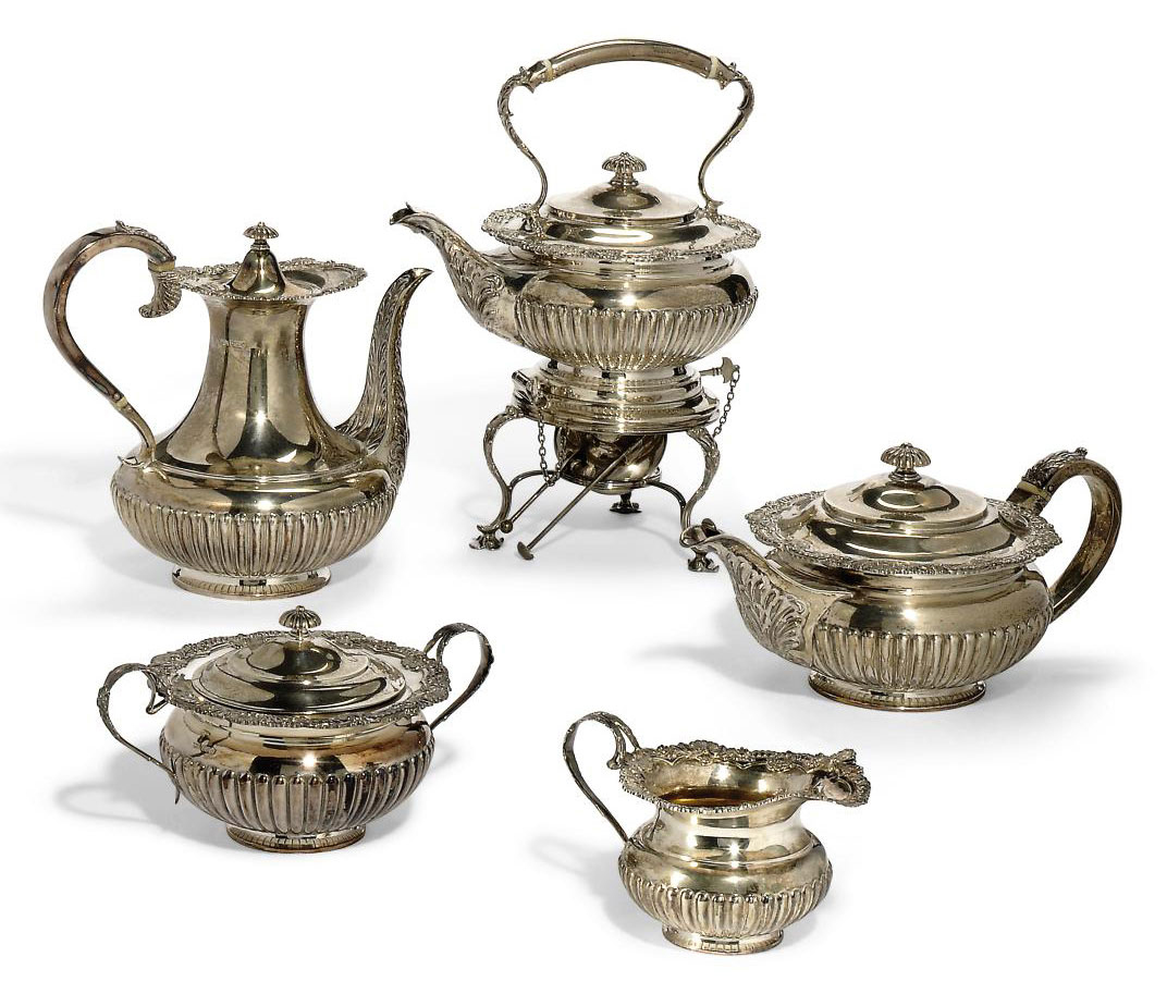 A FOUR-PIECE SILVER TEA SET WITH KETTLE EN SUITE