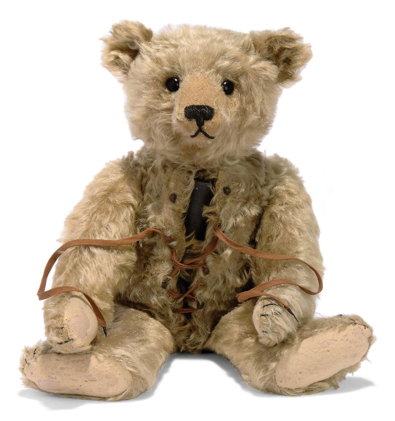 A STEIFF TEDDY BEAR WITH HOT-WATER BOTTLE, (5335,b), jointed, blonde mohair, black boot button eyes, black stitching, metal canister in body, hooks and laces to front seam and FF button, circa 1910 --19¾in. (50cm.) high (some slight wear, repairs to pads and nose restitched)