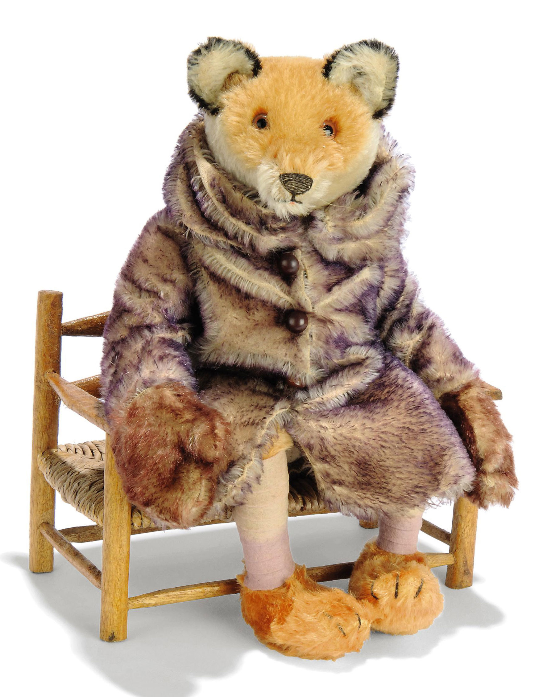 A STEIFF DISPLAY FOX IN FUR COAT, jointed, light brown and white mohair, brown and black glass eyes, black stitching, remains of whiskers, cloth body, legs bent in a seated position, purple-tipped white mohair coat with large collar and four brown buttons, brown-tipped mohair mittens, purple felt spats and FF button, 1920s --14in. (35.5cm.) high (slight fading to head)  (2)