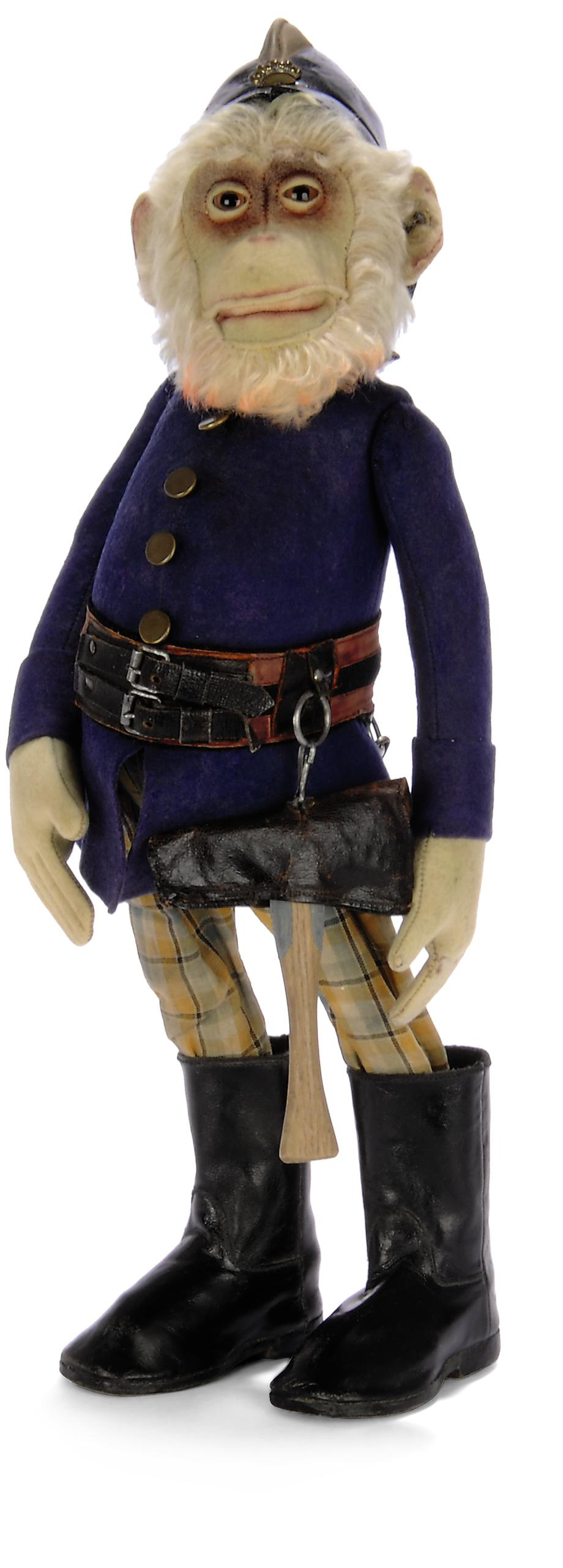 A STEIFF DISPLAY CHIMPANZEE FIREMAN, yellow mohair head, brown and black glass eyes, felt face, ears and hands, open mouth, swivel head, orange-tipped beard, integral blue felt jacket, jointed arms and legs, checked trousers, black leather boots, belt with axe and rope attached, brass buttons, pressed leather helmet with brass crown badge and FF button, 1920s --18in. (45.5cm.) high (some fading and slight wear)