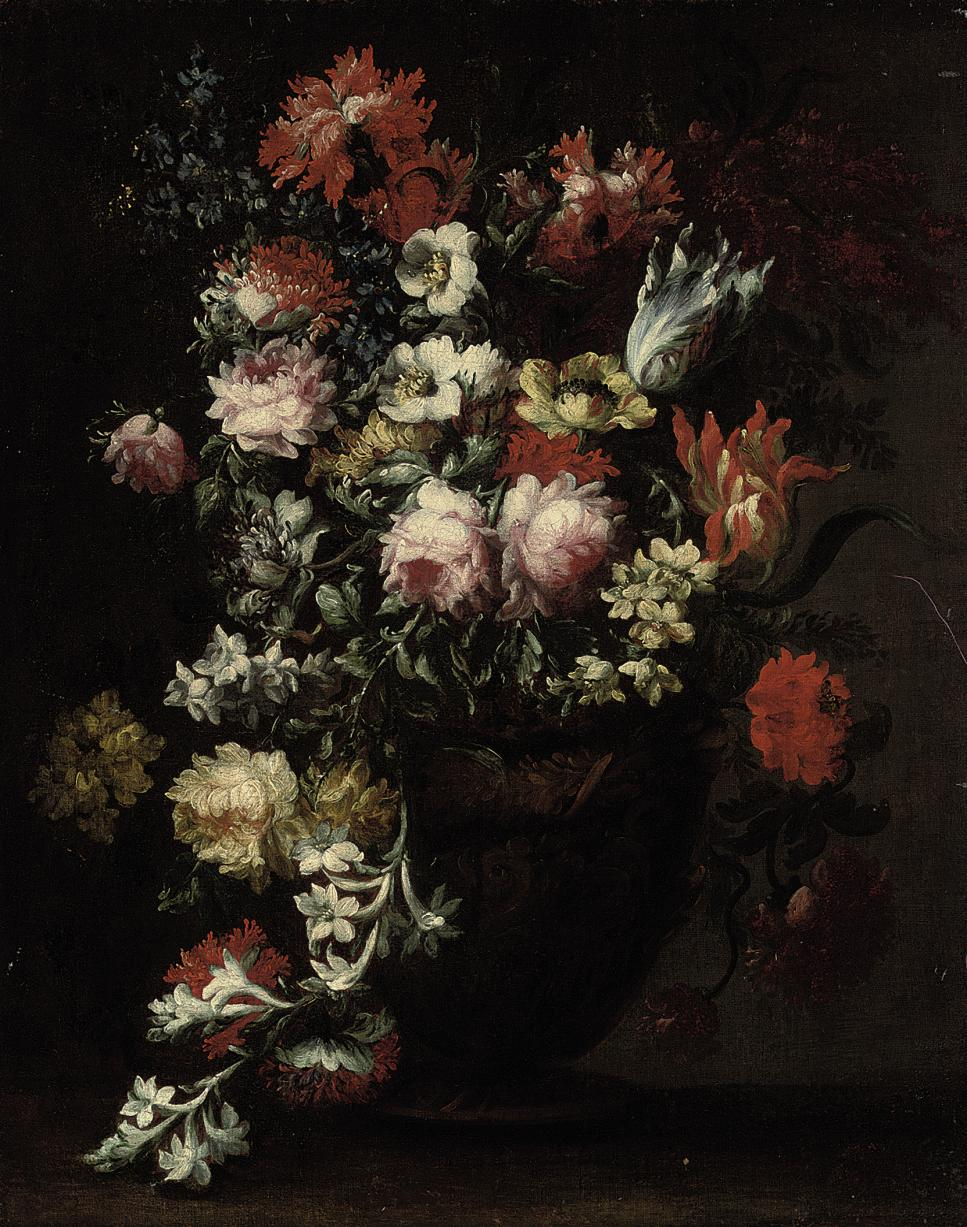 Chrysanthemums, roses, parrot tulips, anemonies and other blooms in an urn