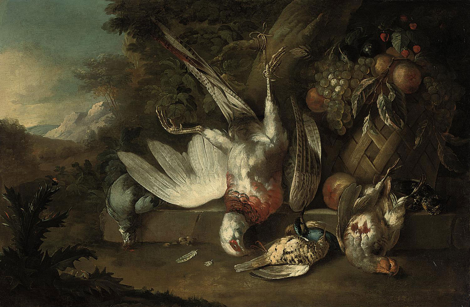 Dead birds and grapes, plums, peaches and strawberries in a basket on a ledge in a landscape