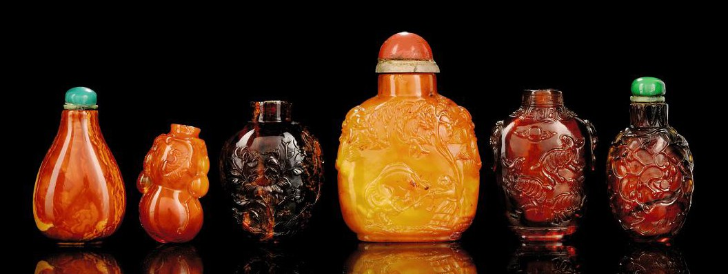 SIX CARVED AMBER SNUFF BOTTLES