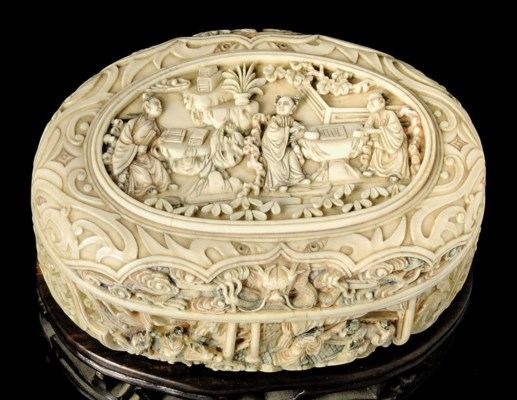 A CARVED AND STAINED IVORY BOX