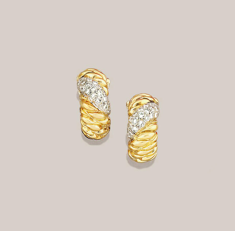 A pair of diamond earclips, by Vourakis