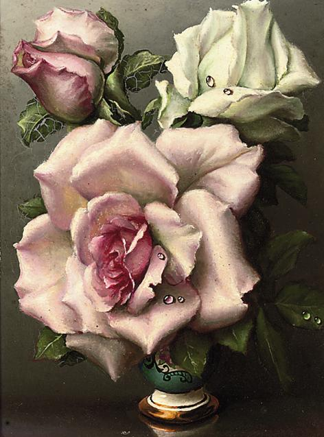 Pink and white roses in an ornamental vase