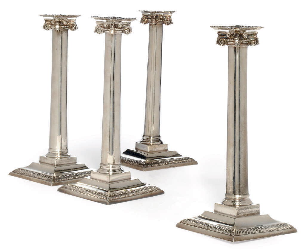 A MATCHED SET OF FOUR GEORGE III SILVER IONIC COLUMN CANDLESTICKS