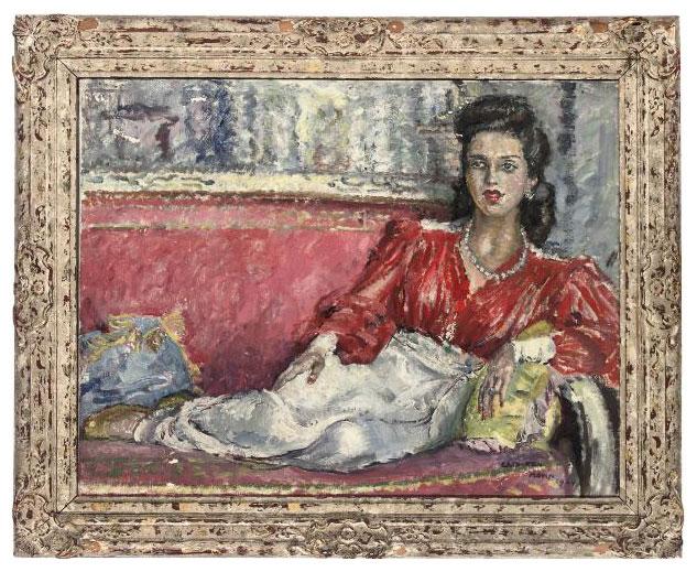 Portrait of an elegant lady, full-length, reclining on a sofa