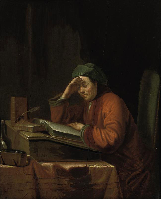 A man reading in an interior