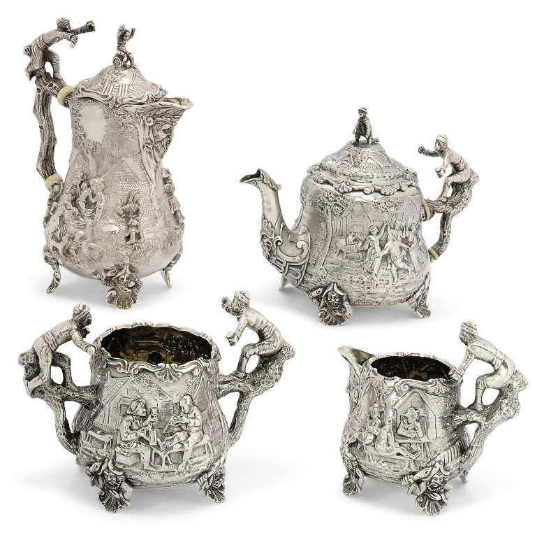 A VICTORIAN FOUR-PIECE SILVER TEA SERVICE IN THE STYLE OF EDWARD FARRELL