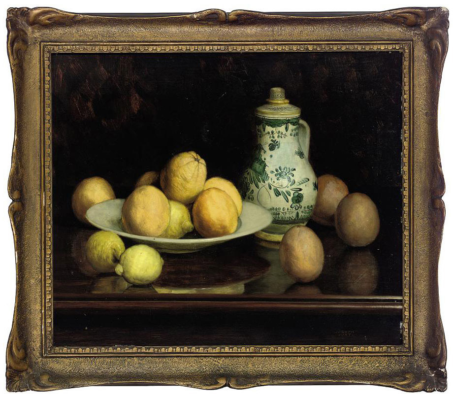 A jug, oranges and lemons on a table