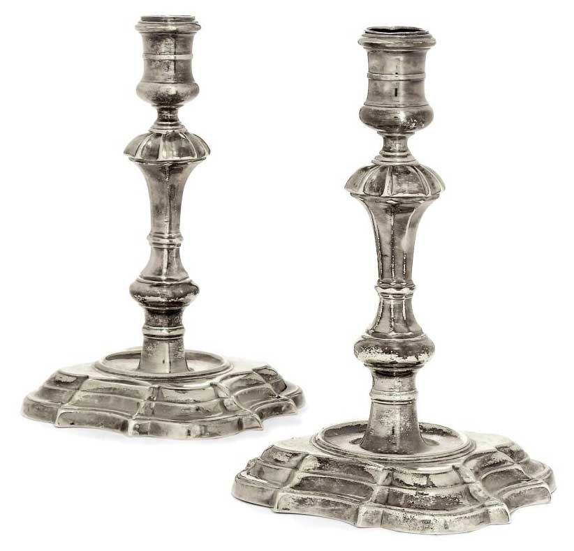 A PAIR OF GEORGE II CAST SILVER CANDLESTICKS