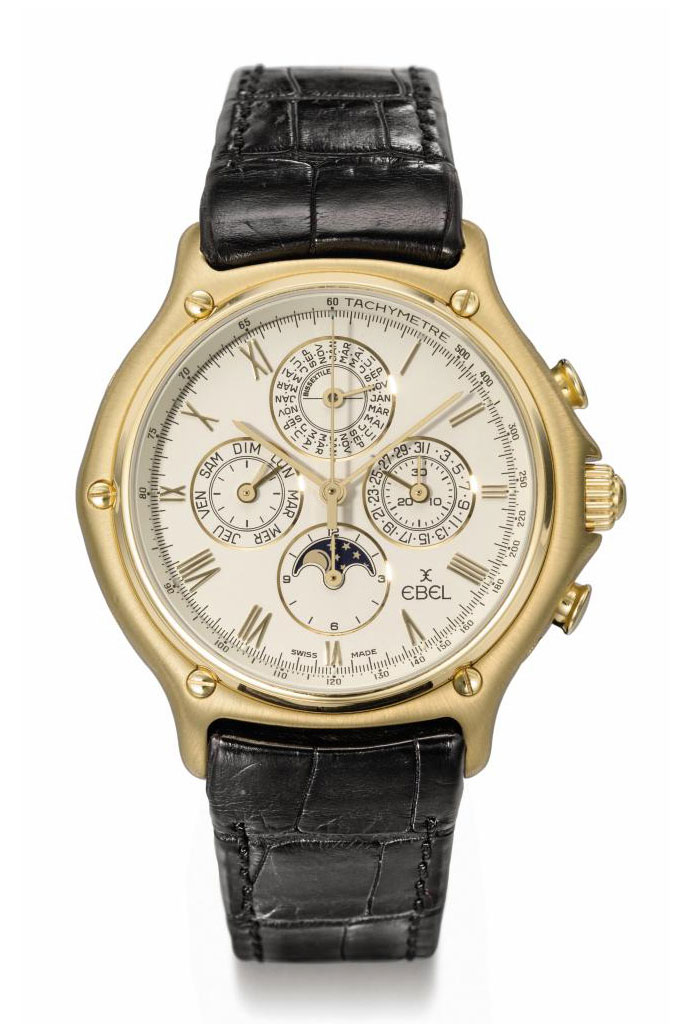 Ebel. An 18K gold tonneau-shaped automatic perpetual calendar chronograph wristwatch with moon phases