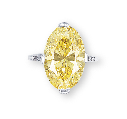 A SUPERB COLOURED DIAMOND AND DIAMOND RING, BY TIFFANY & CO.