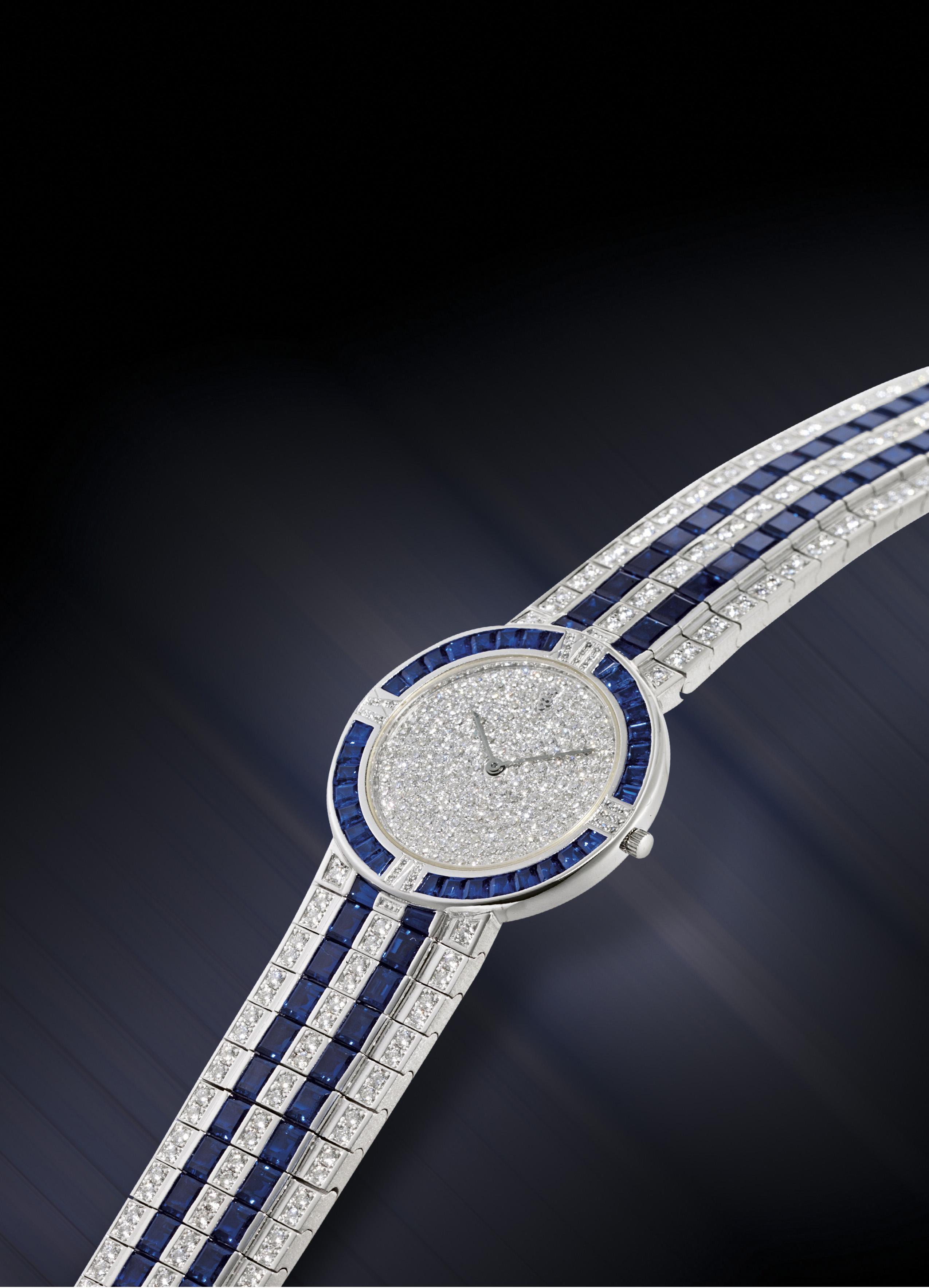 CORUM  IMPRESSIVE PLATINUM, DIAMOND AND SAPPHIRE-SET QUARTZ WRISTWATCH WITH BRACELET