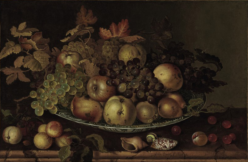 Fruit in a wan-li kraak with shells and other fruit on a table