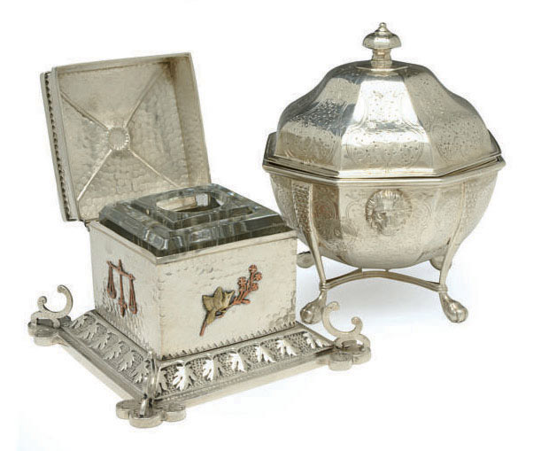 AN AMERICAN SILVER BUTTER COOLER WITH HINGED COVER AND LINER ON FOUR FEET, AND AN AMERICAN SILVER AND MIXED METAL INKWELL WITH HINGED COVER,