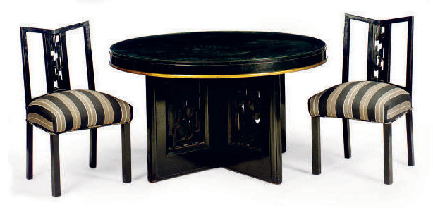 AN EBONIZED AND PARCEL GILT UPHOLSTERED DINING SUITE,