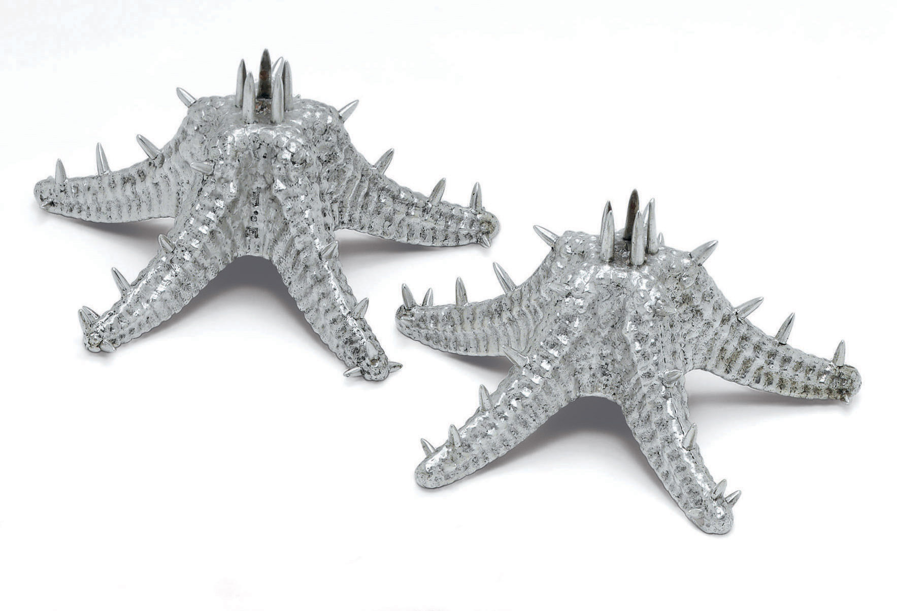 A PAIR OF PORTUGUESE SILVER STARFISH CANDLESTICKS