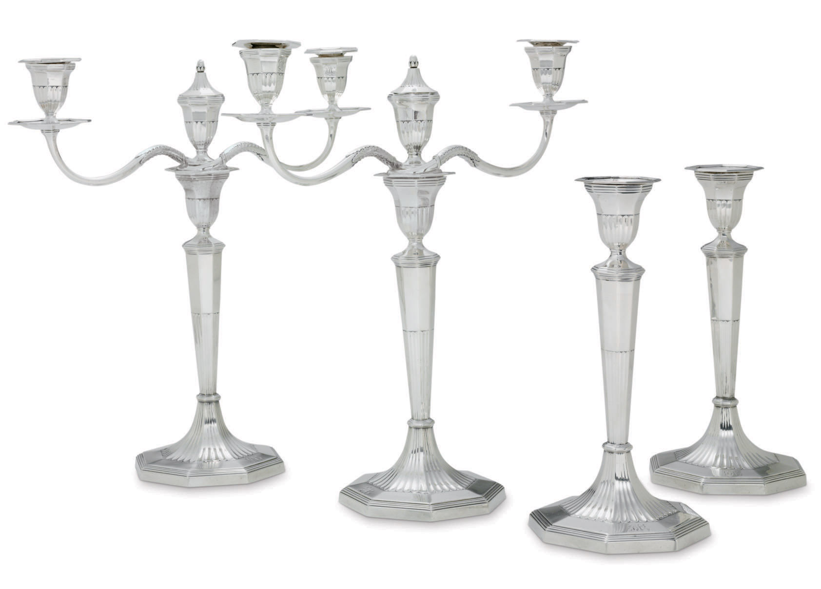 A PAIR OF GEORGE III SILVER THREE-LIGHT CANDELABRA WITH TWO MATCHING CANDLESTICKS
