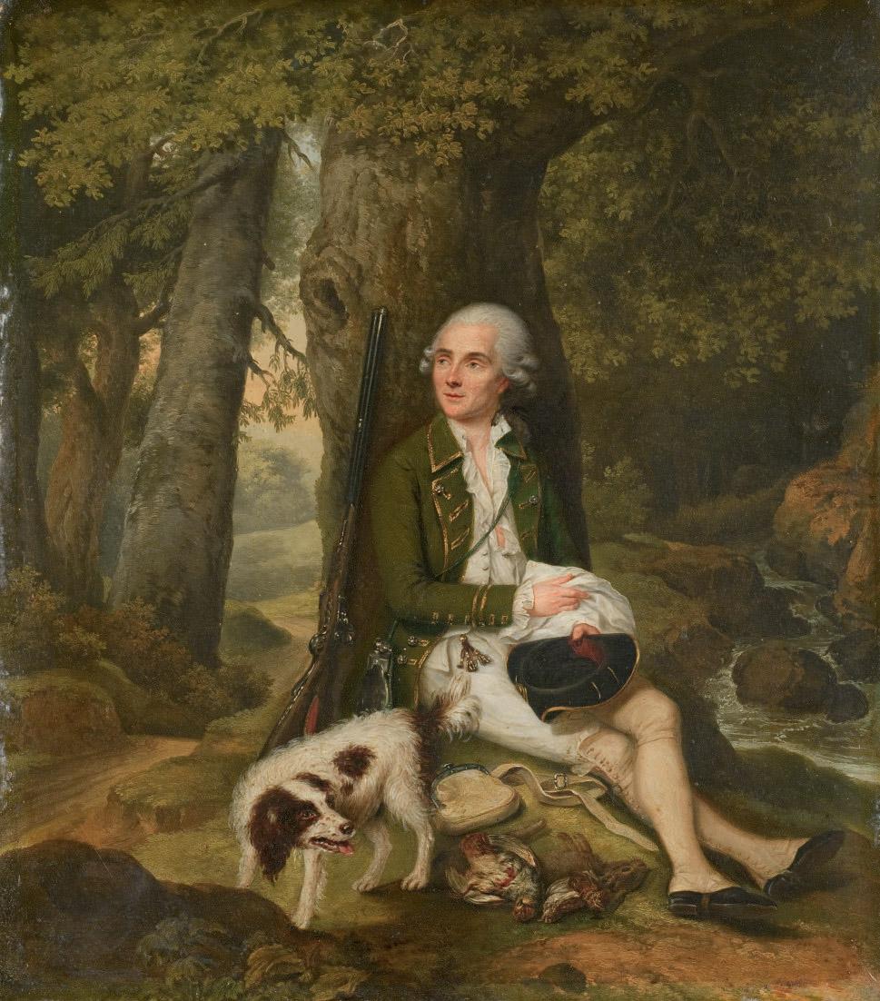 Chasseur au repos près d'une rivière avec son chien
