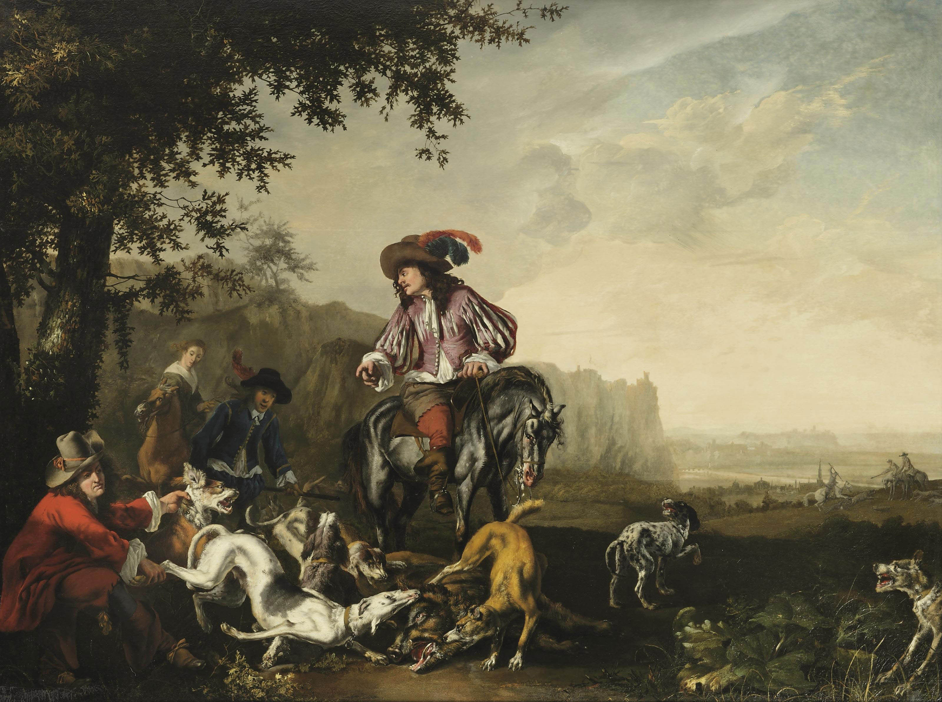 An Italianate landscape with an elegant company on a hunt, dogs catching a wild boar in the foreground