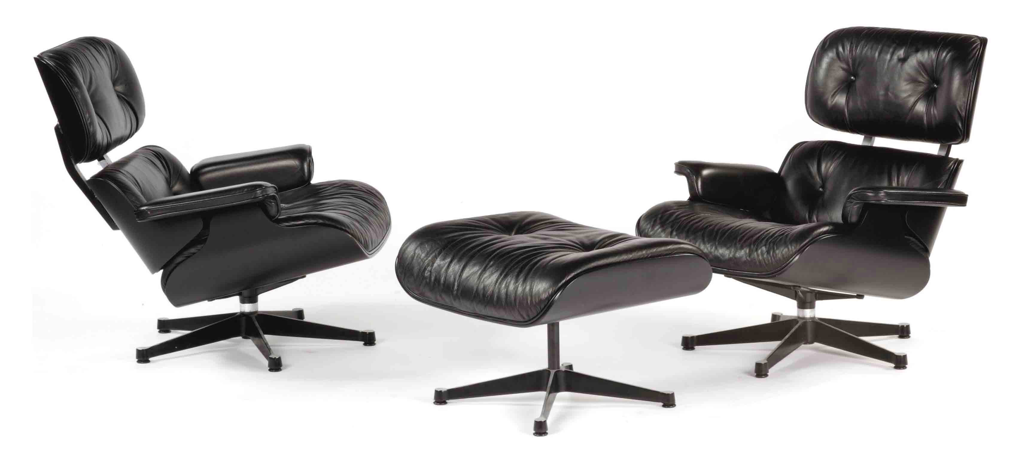 TWO BLACK LAMINATED AND ALUMINUM 'MODEL NO. 670' LOUNGE CHAIRS AND ONE 'MODEL NO. 671' OTTOMAN