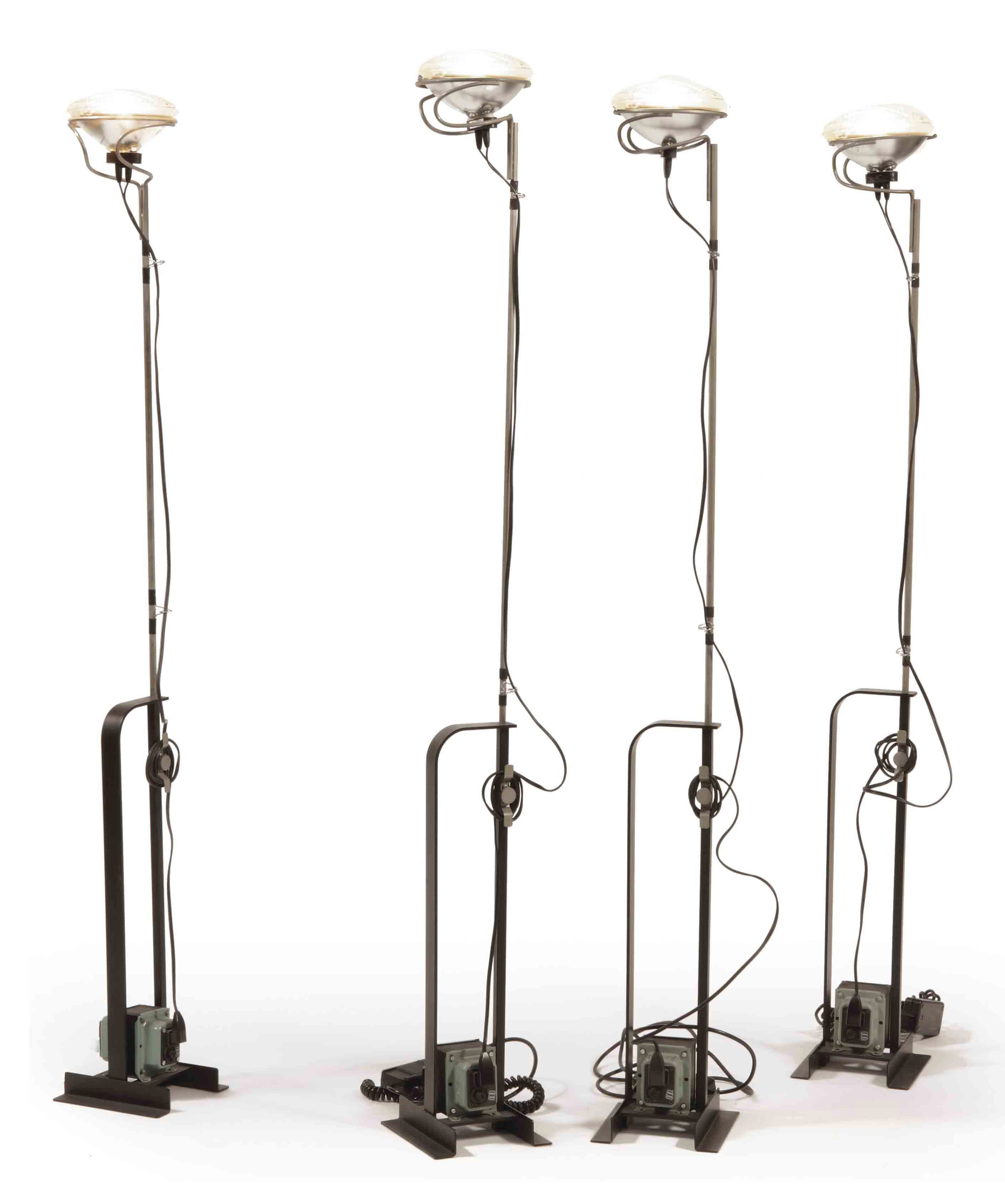 A SET OF FOUR CHROME STEEL AND METAL 'TOIO' FLOOR LAMPS