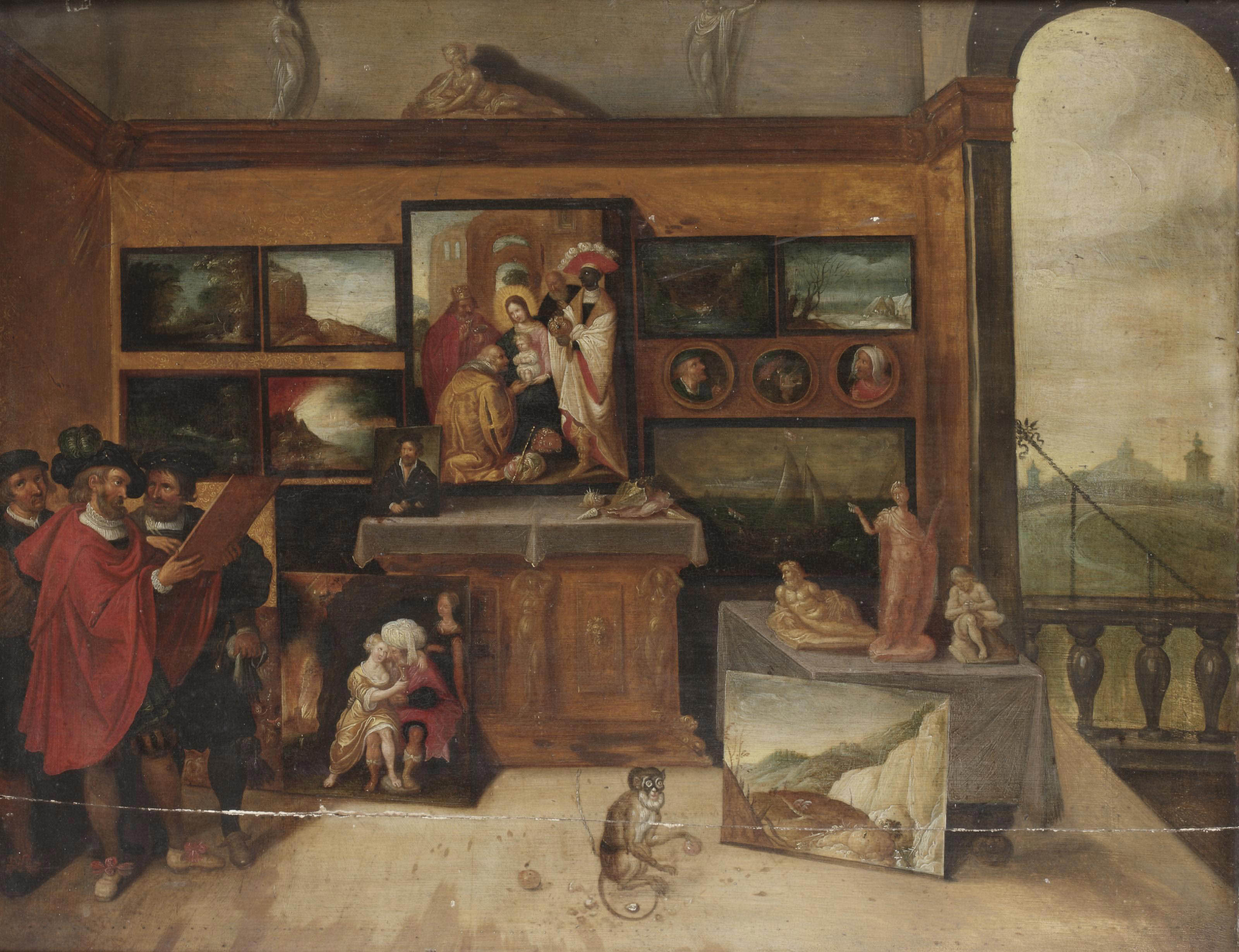 The interior of a picture gallery with connoisseurs studying a painting