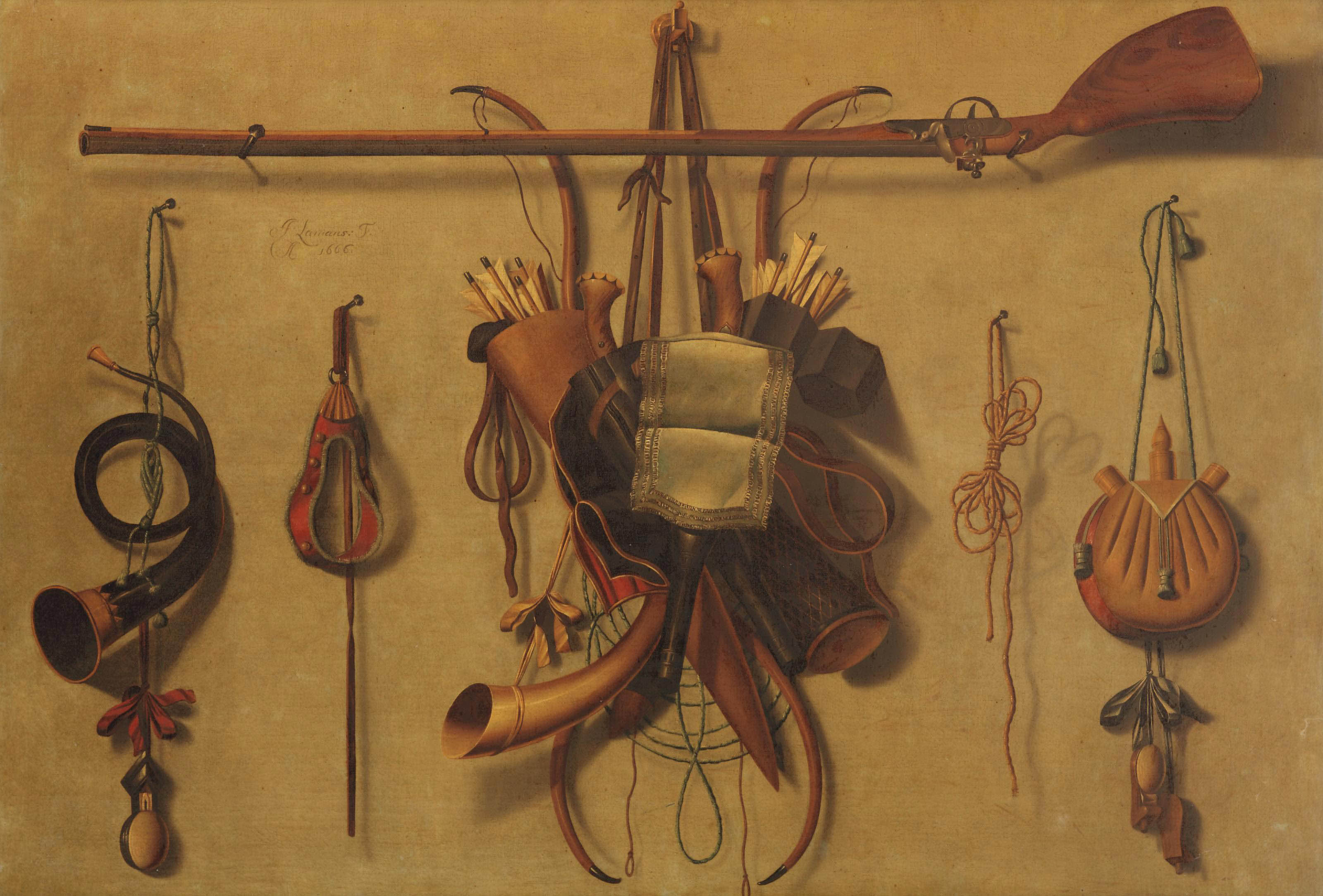 A 'trompe l'oeil' still life with hunting paraphernalia hanging on a wall