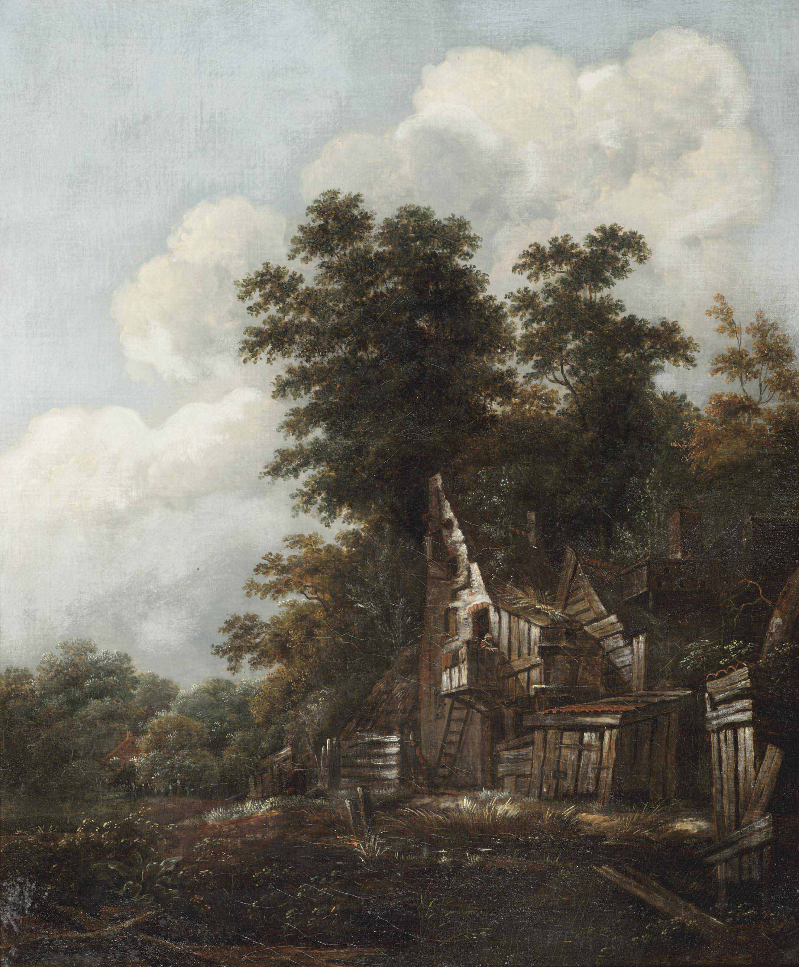 A wooded landscape with figures outside a ruinous cottage