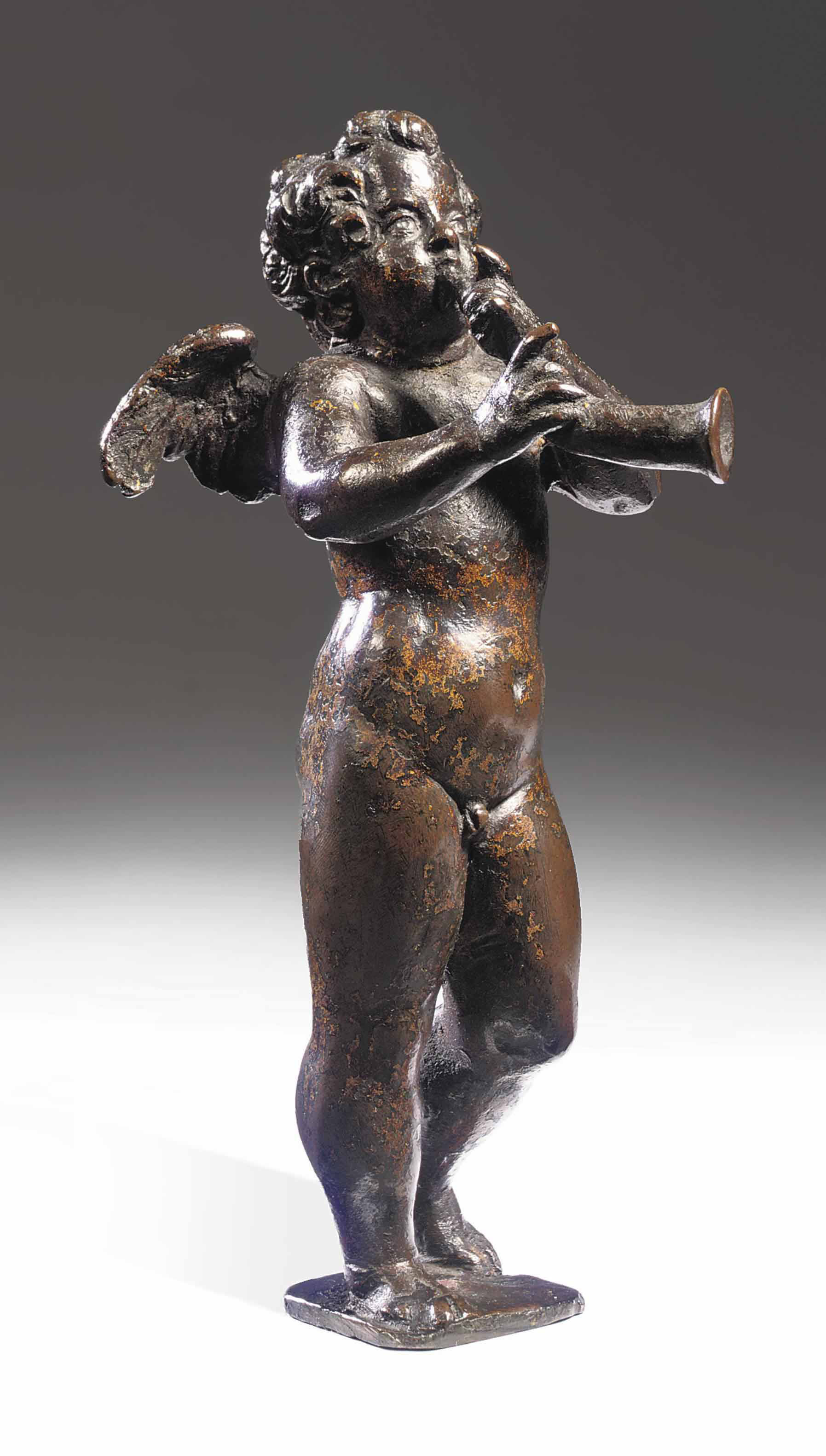 A BRONZE FIGURE OF A PUTTO PLAYING THE HORN