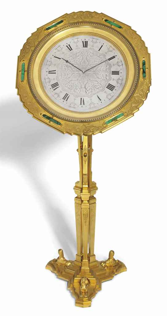 A HIGHLY UNUSUAL VICTORIAN GILT-BRASS MALACHITE-MOUNTED STRIKING EIGHT DAY TURN-TABLE TRIPOD CLOCK