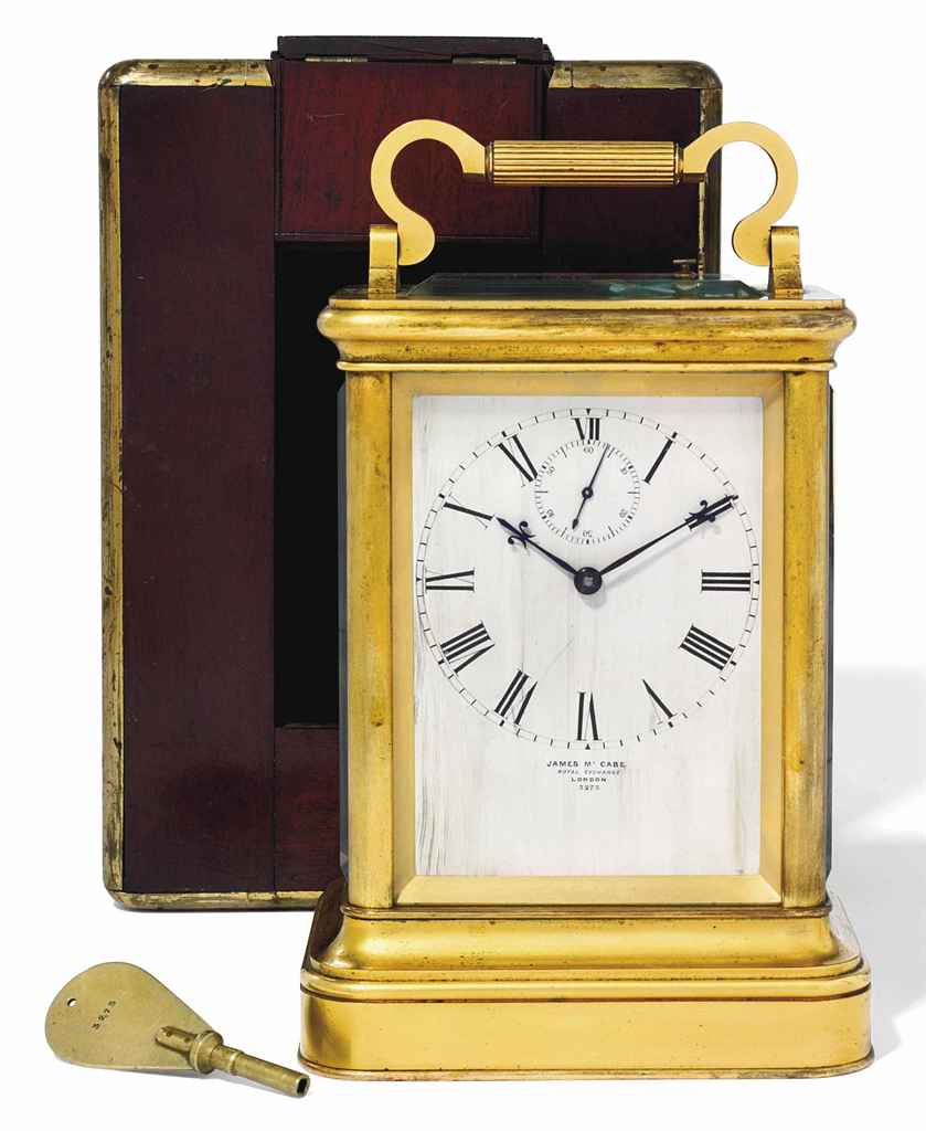 A VICTORIAN GIANT GILT-BRASS STRIKING AND REPEATING EIGHT DAY CARRIAGE CLOCK